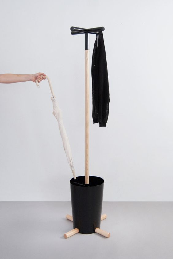 a modern coat rack with a so-called pot for umbrellas and a coat rack looks bold and catchy