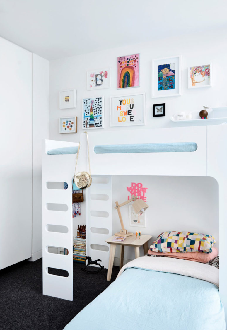 This is the first kids' room done in pastels and with lots of artworks