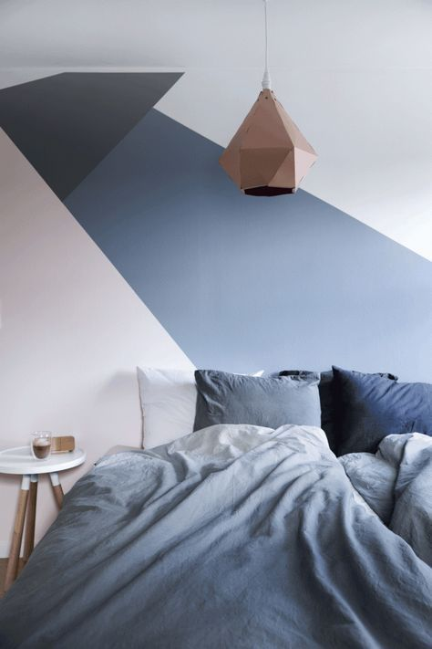 a geometric color block bedroom in blush, navy, black and white and a matching bedding set