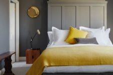10 a grey space spruced up with natural wood, gilded touches and some yellow touches