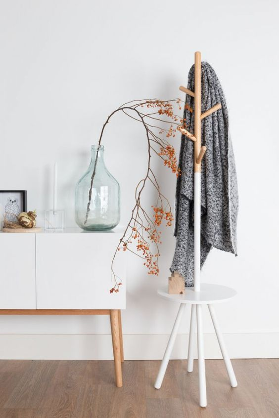 a stylish and simple combo of a coat rack and a little entryway table or seat - as you wish
