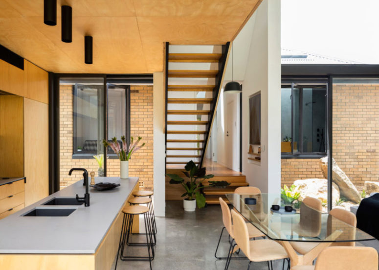 Glass walls fill the spaces with light and make the owners enjoy the inner courtyards