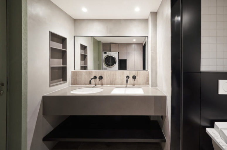 The master bathroom is done in black and white, with neutrals and a double floating vanity