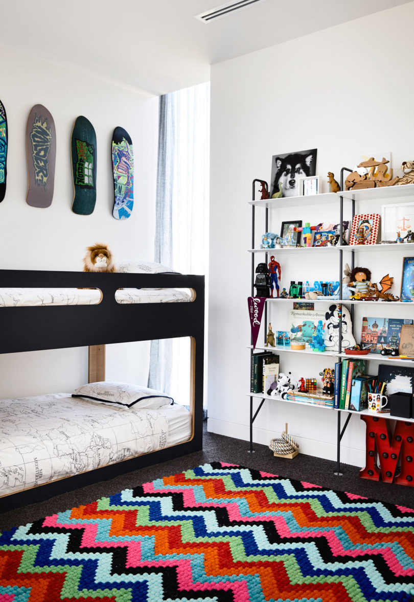 The second room is done with bright colors and touches of black plus kateboards on the wall