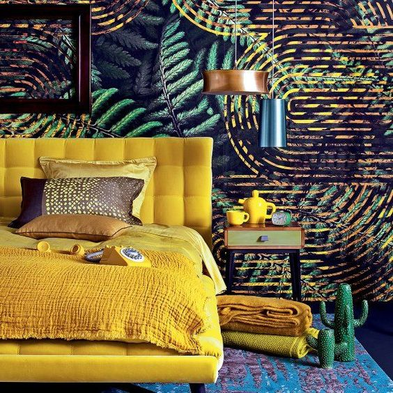 a bold yellow upholstered bed with bedding and blankets of the same color for a touch of sun