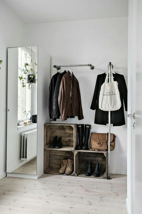 a metal holder for clothes hangers and one more L-shaped coat rack for hanging pieces with style