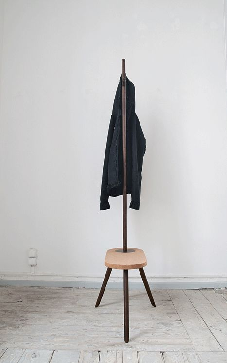 a very simple coat rack with an additional stool as a base of it is a great combo for a tiny space