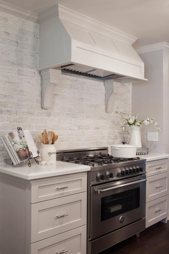 a whitewashed brick backsplash is a cool and chic idea to add texture to your kitchen