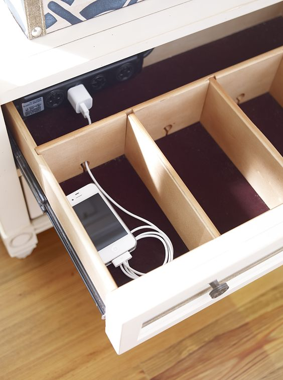 go for a hidden charging station like this one to make the space decluttered