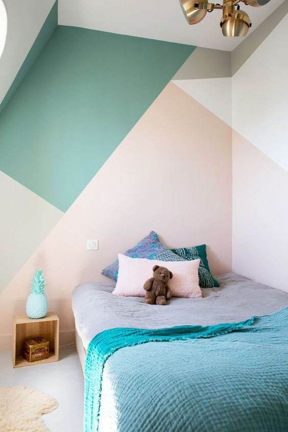 a kid's bedroom is spruced up with color blocking in green, pink, grey and cream, a bold and creative idea