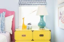 12 a large and functional dresser nightstand in bold yellow with metallic handles
