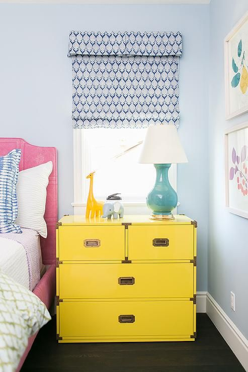 a large and functional dresser nightstand in bold yellow with metallic handles