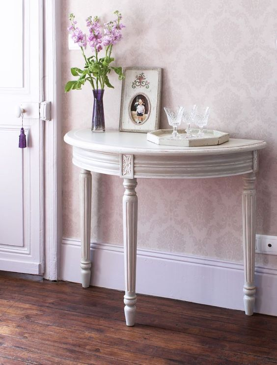 a vintage grey console table with elegant legs will add a refined touch to your space