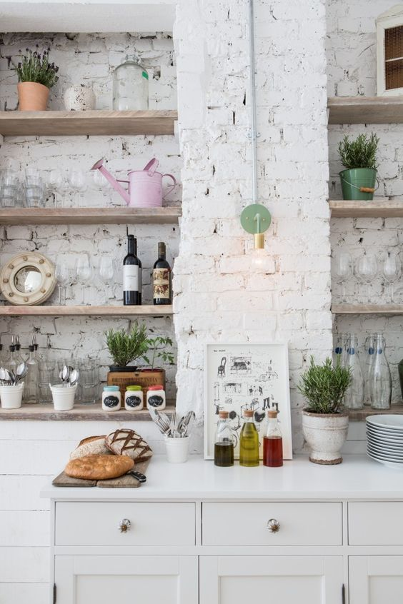 gorgeous whitewashed brick walls create a serene feel in this kitchen