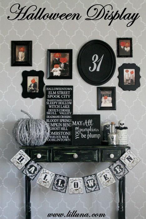 a shabby chic green console, a bunting, Halloween photos and signs and twig pumpkin