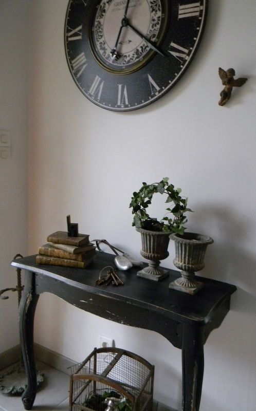 a vintage rustic half console painted black to add a touch of elegance to the space