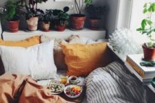 13 cozy bedding with orange and rust touches – pillowcases and a blanket for a fall space
