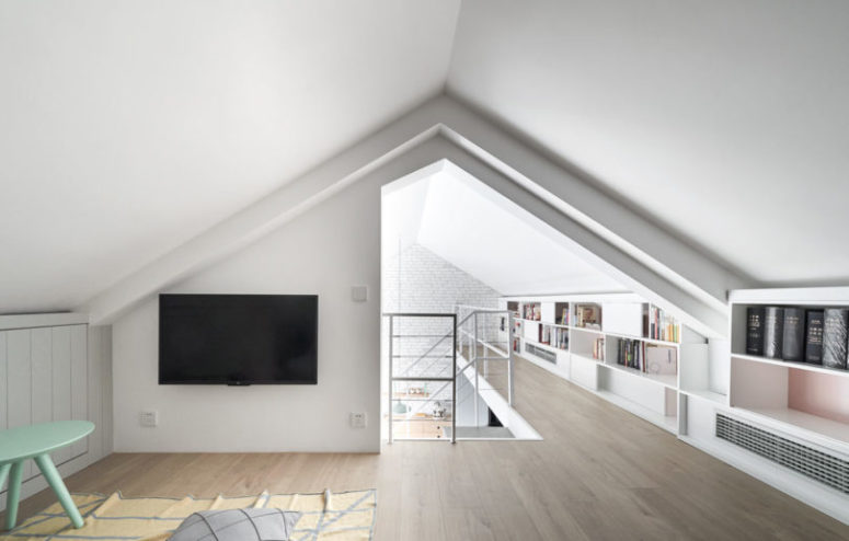 The upper floor features a TV watching space, too