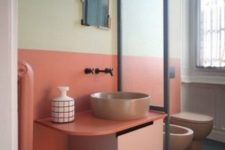 14 a light yellow and coral plus matching pinkish fixtures for the powder room to give it a mid-century modenr feel