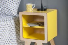 14 a modern nightstand of yellow lacquer and plywood with open storage for a bold touch