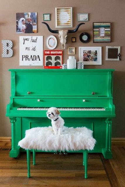 a neon green piano and a faux fur stool plus a gallery wall with bright artworks and photos