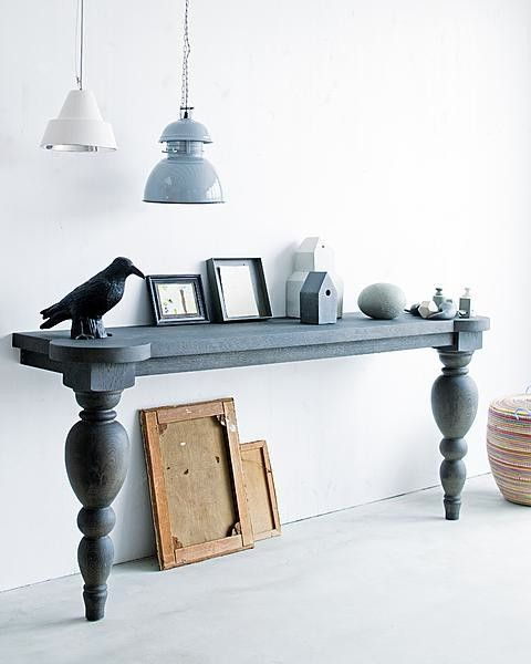 a whimsy living room console with chic legs is a long narrow piece that provides enough storage