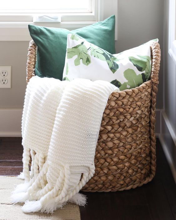 store your pillows and a blanket in a chic basket, it's very affordable and adds coziness