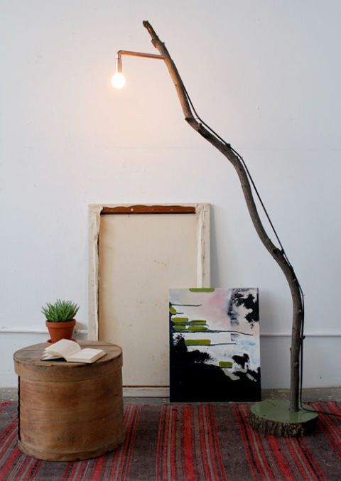 such a floor lamp of a long branch, a wood slice base and an industrial bulb can be easily DIYed