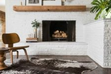 14 whitewashed brick walls and a fireplace clad this way for a mid-century modern living room
