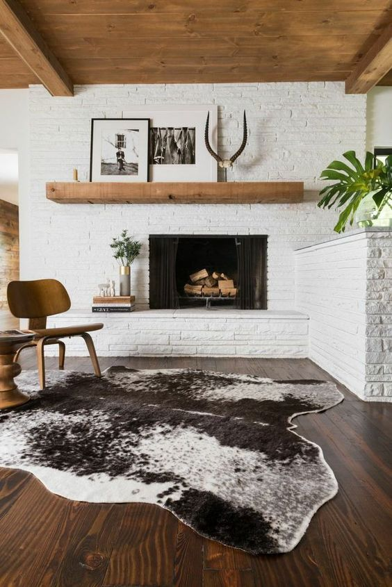 whitewashed brick walls and a fireplace clad this way for a mid-century modern living room