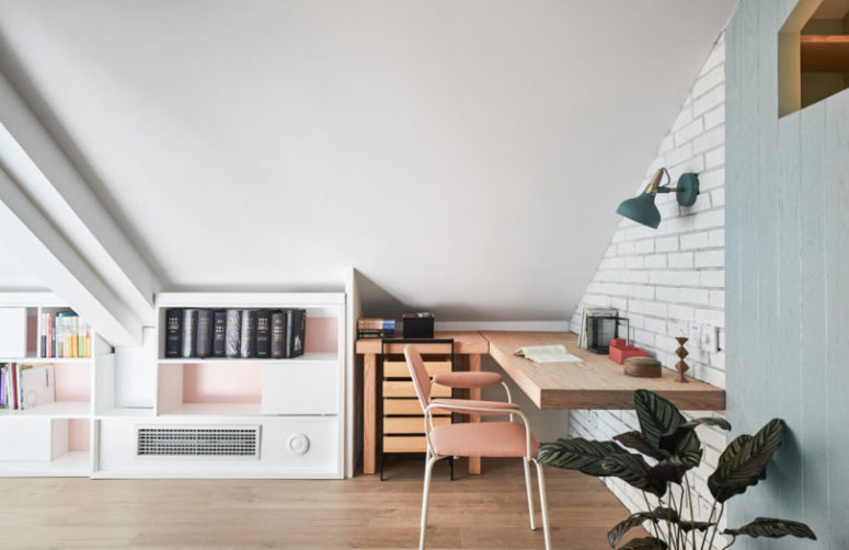 Here you may see a working space in the corner with a floating desk and a storage piece