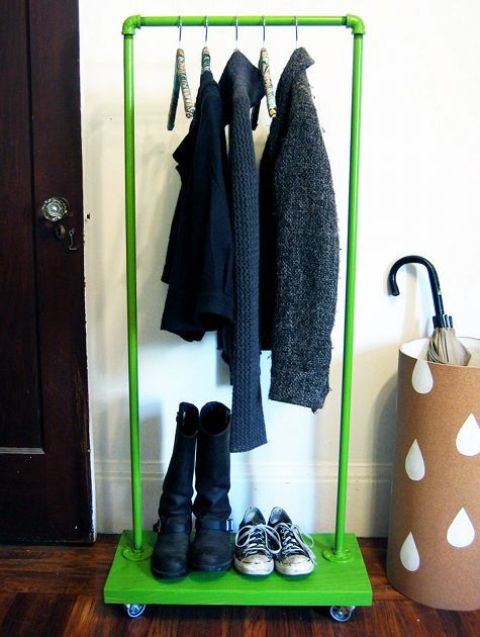 a colorful clothes rack with a base on casters used for shoe storage is a great idea to add a touch of color