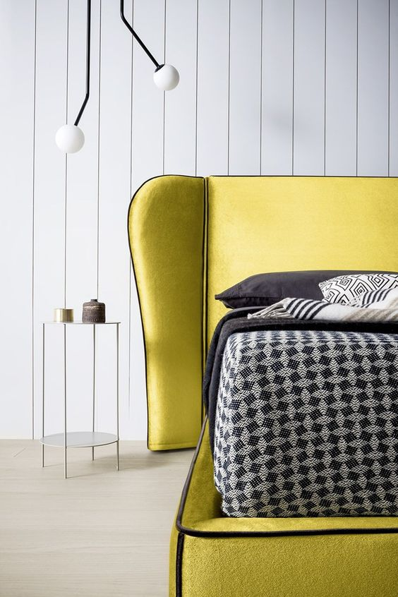 an ultra-modern lemon yellow bed plus dark bedding and pillows for a bright look