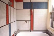 15 bathroom walls clad with tiles with a color block effect, in white, blue and red make the space stand out
