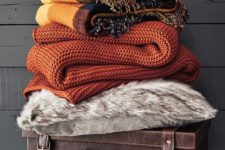 15 bring colorful blankets and a faux fur throw to your bedroom to add texture and interest plus coziness