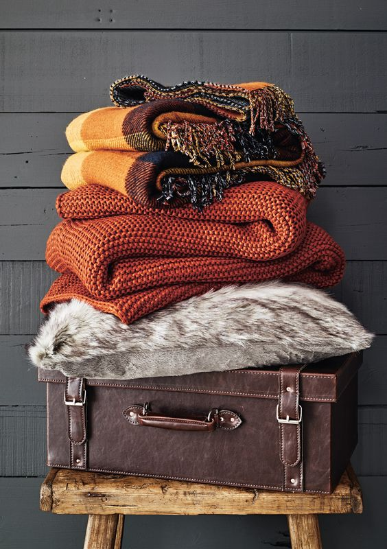 bring colorful blankets and a faux fur throw to your bedroom to add texture and interest plus coziness