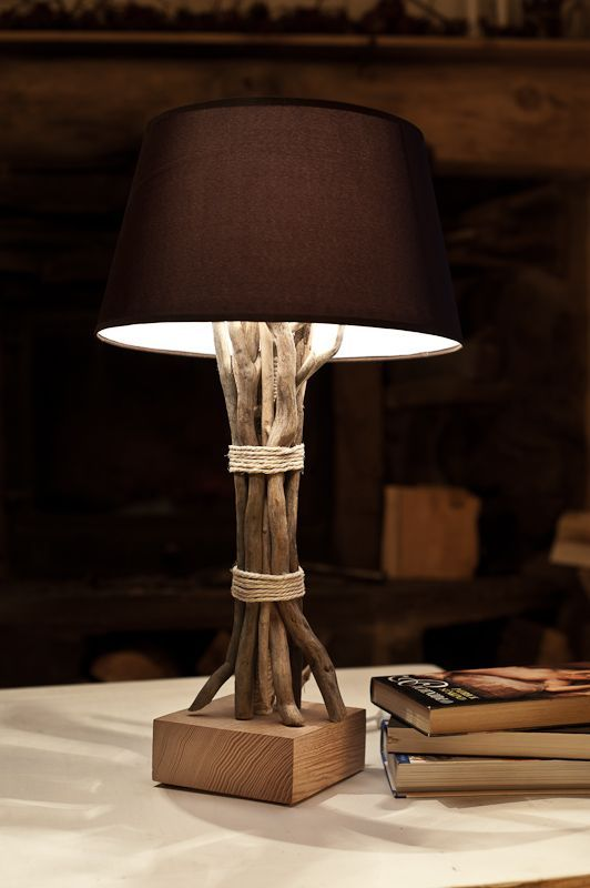 make your usual table lamp natural covering the base with branches and tying it up with simple yarn