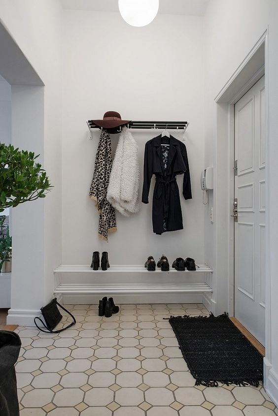 a stylish contemporary coat rack of metal is a comfy and simple piece for a monochromatic space