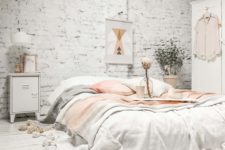 16 a whitewashed brick wall and a whitewashed wood floor make the space interesting playing with textures
