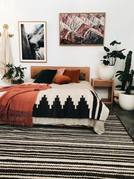 add a large warm rug and matching blankets plus velvet pillows, so you'll get a cool fall space