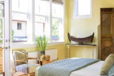 16 light yellow walls and a bold yellow bed create a look of a room filled with sunlight every day
