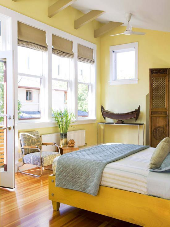 light yellow walls and a bold yellow bed create a look of a room filled with sunlight every day