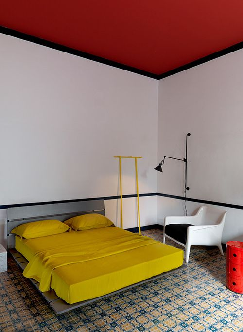 make your bedroom bold with a bright red ceiling and a bold bedding set