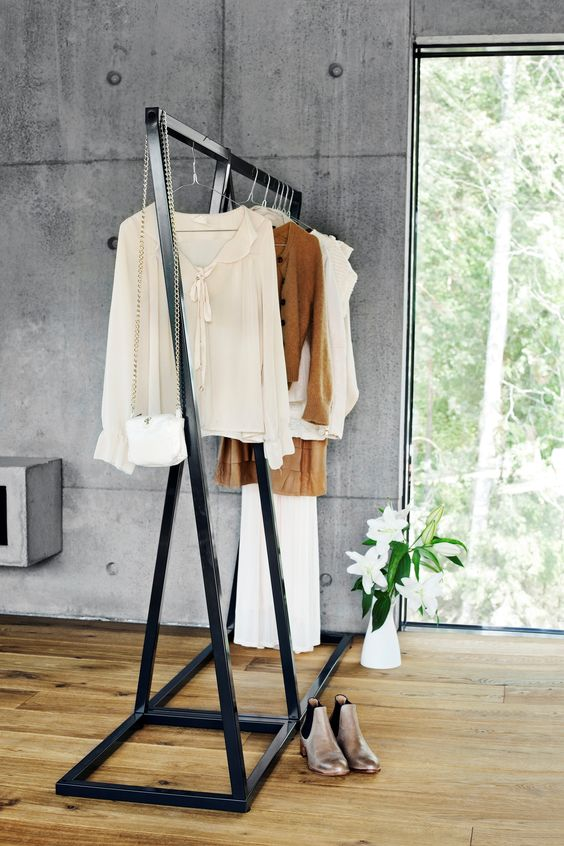 a large blackened metal clothes rack is very stable and can hold a lot of items, you may use it in your closet, too