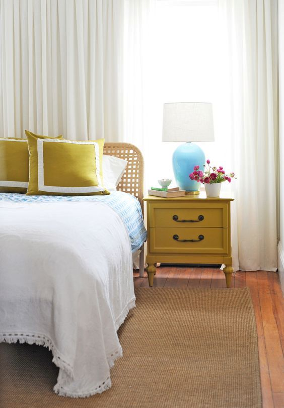 a vintage mustard nightstand and matching pillows to add a touch of color