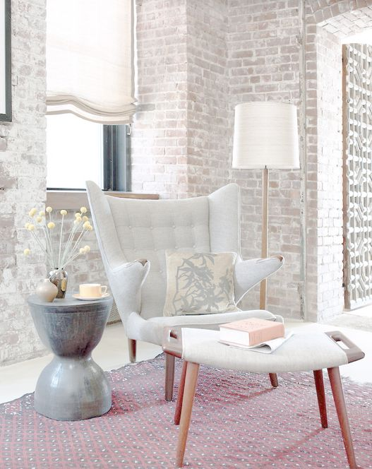 a whitewashed brick wall for a relaxed and subtle living room but with a bit of edge