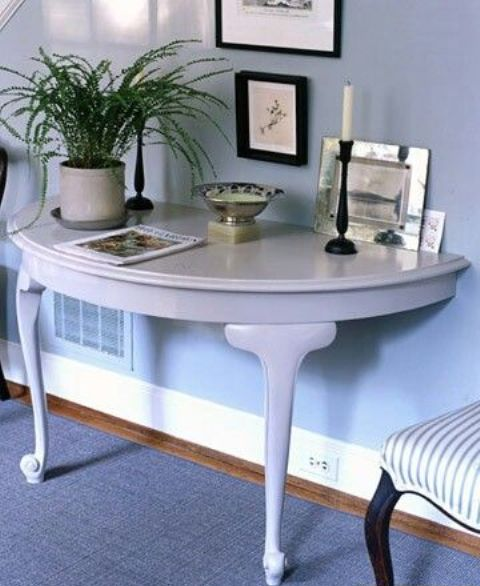 if you have enough space but want to add something catchy to your entryway, a half round console is ideal