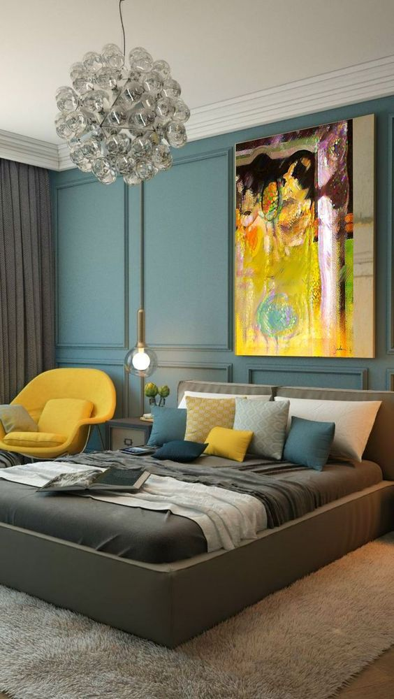 a bright yellow chair, a pillow and a bold artwork with yellow as the main shade for a luxurious bedroom