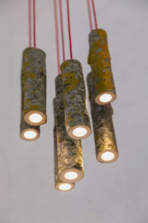 a cluster of awesome pendant lamps made of old tree branches and red cord for a contrasting look