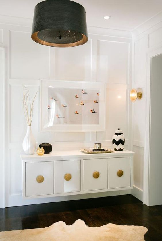 a refined floating console table in white and gold for a luxurious or glam entryway